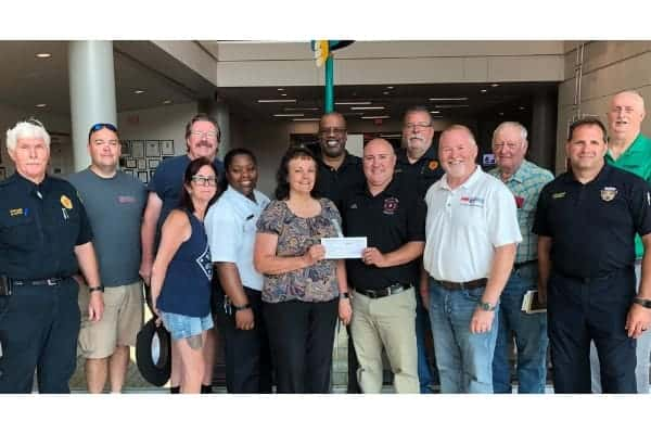 group photo - passing donation check